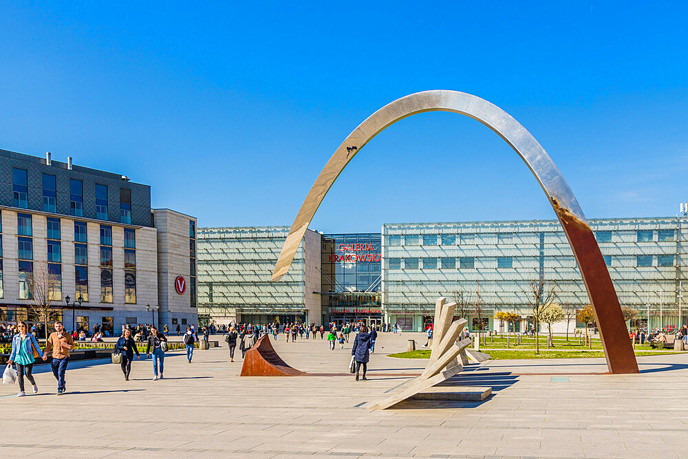 The Pomnik Ryszarda Kuklińskiego w Krakowie sculpture and the Galeria Krakowska Shopping centre mall in Krakow, Poland, Europe.