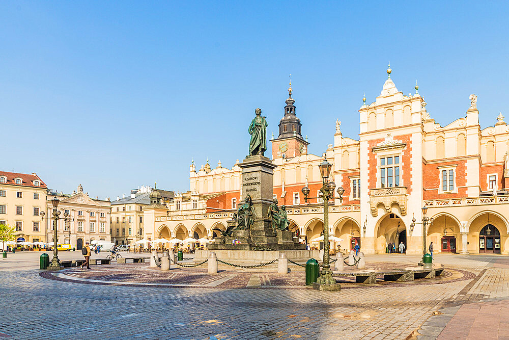 Adam Mickiewicz Monument & Cloth Hall in the main Square in the medieval old town, a UNESCO World site in Krakow, Poland, Europe - 1297-937