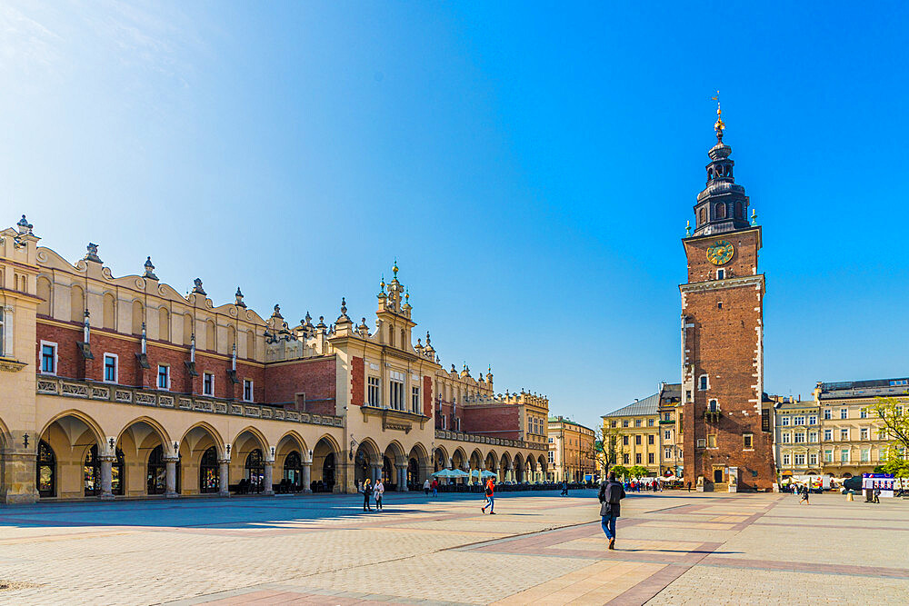 Cloth Hall and the Town Hall Tower in the Main Square in the medieval old town, a UNESCO World site, in Krakow, Poland, Europe - 1297-942