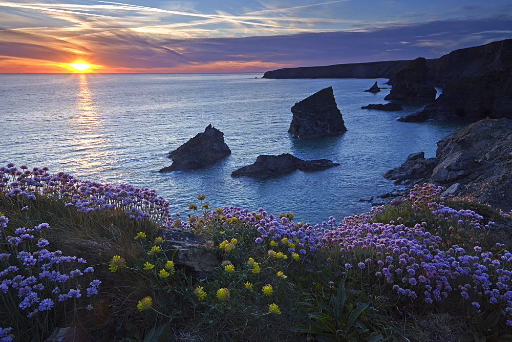 Sunset over Bedruthan Steps, Carnewas, Cornwall, England, United Kingdom, Europe.