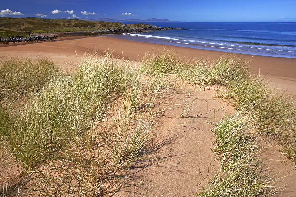 The remote sandy beach at Red Point with the Isle of Skye on the horizon, Wester Ross, Scotland, United Kingdom, Europe.