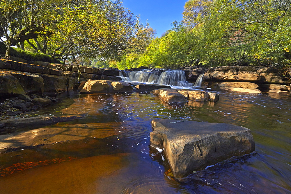 Autumn at lower Wainwath Falls, Swaledale, Yorkshire Dales, North Yorkshire, England, United Kingdom, Europe