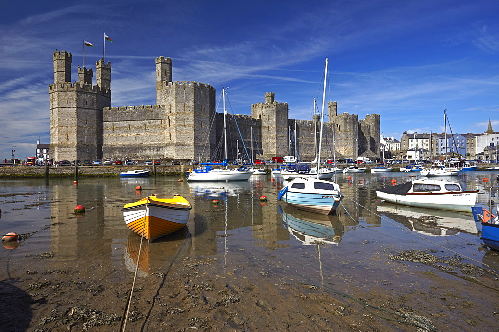 Boats moored near Caernarfon Castle, UNESCO World Heritage Site, Gwynedd, Wales, United Kingdom, Europe