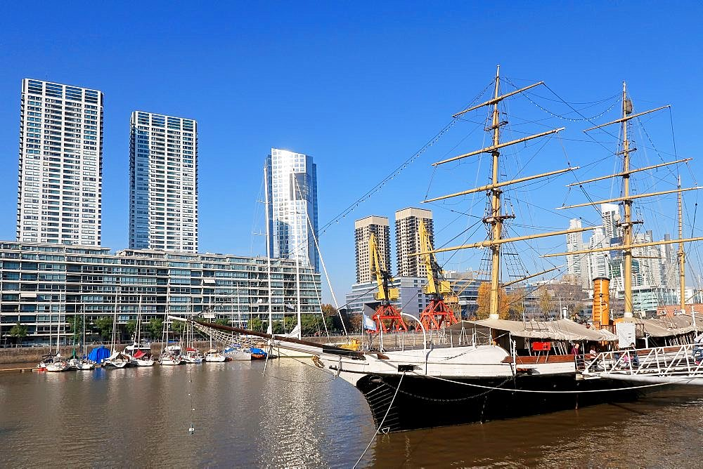 Historic sailing ship on Rio de la Plata river in the modern district Puerto Madero, Buenos Aires, Argentina, South America