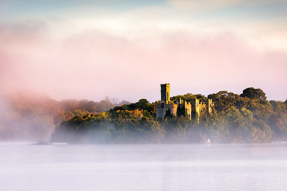 Mist at sunrise at McDermott's Castle on Lough Key or Castle Island in County Roscommon, Connacht, Republic of Ireland, Europe