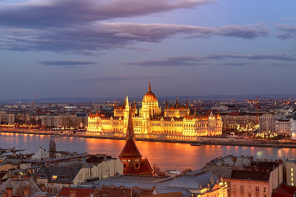 The Hungarian Parliament and the River Danube at night, UNESCO World Heritage Site, Budapest, Hungary, Europe