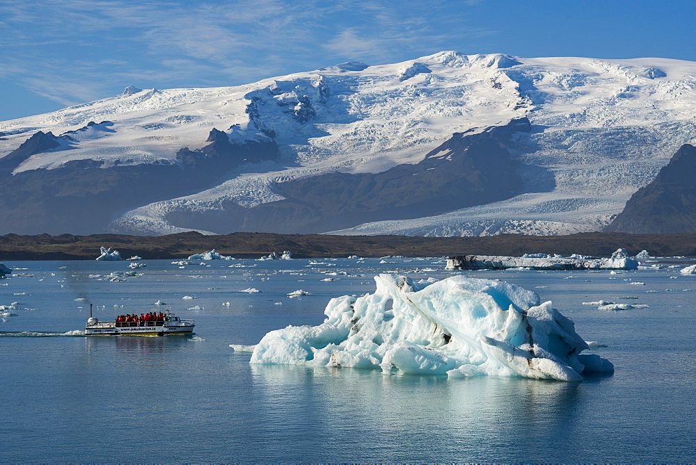 A boat tour on Jokulsarlon Glacier Lagoon, with Breidamerkurjokull Glacier behind, South East Iceland, Iceland, Polar Regions