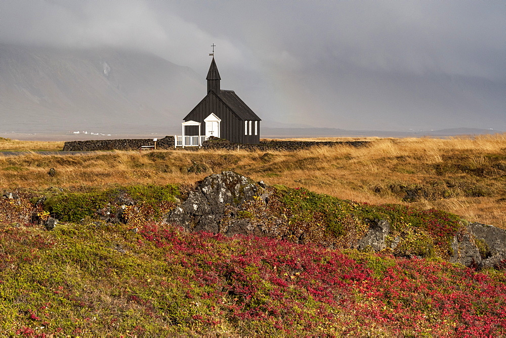 Budir Black church in autumn backed by the Snaefellsnes mountains, Budir, Snaefellsnes Peninsula, Iceland, Polar Regions