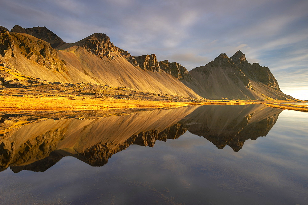 View of mountains of Vestrahorn and perfect reflection in shallow water, soon after sunrise, Stokksnes, South Iceland, Iceland, Polar Regions
