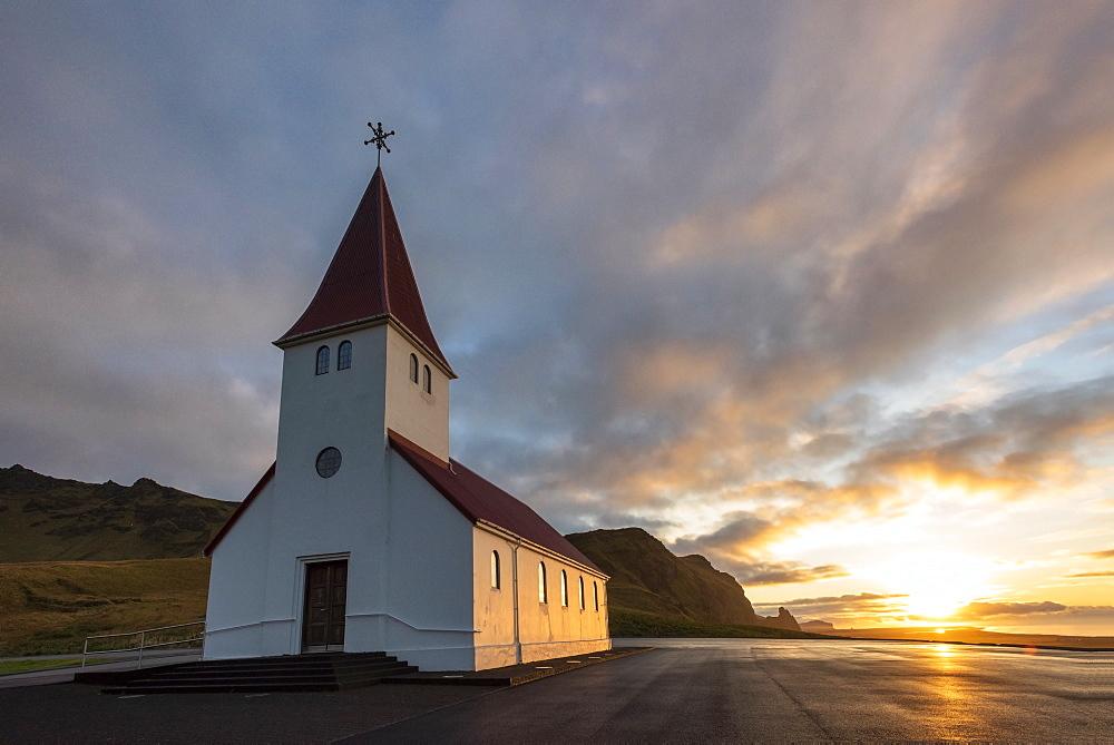 Vik church at sunrise, near Vik, South Iceland,
