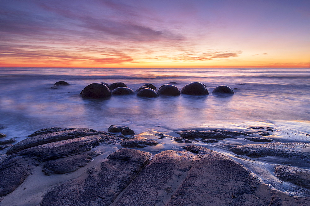 The Moeraki Boulders with incredible sunrise, Moeraki Beach, Otago, South Island, New Zealand, Pacific