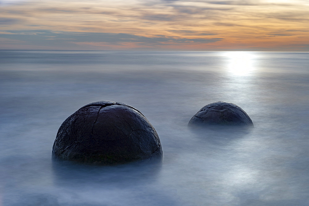 Two Moeraki Boulders at sunrise with long exposure, Moeraki Beach, Otago, New Zealand.