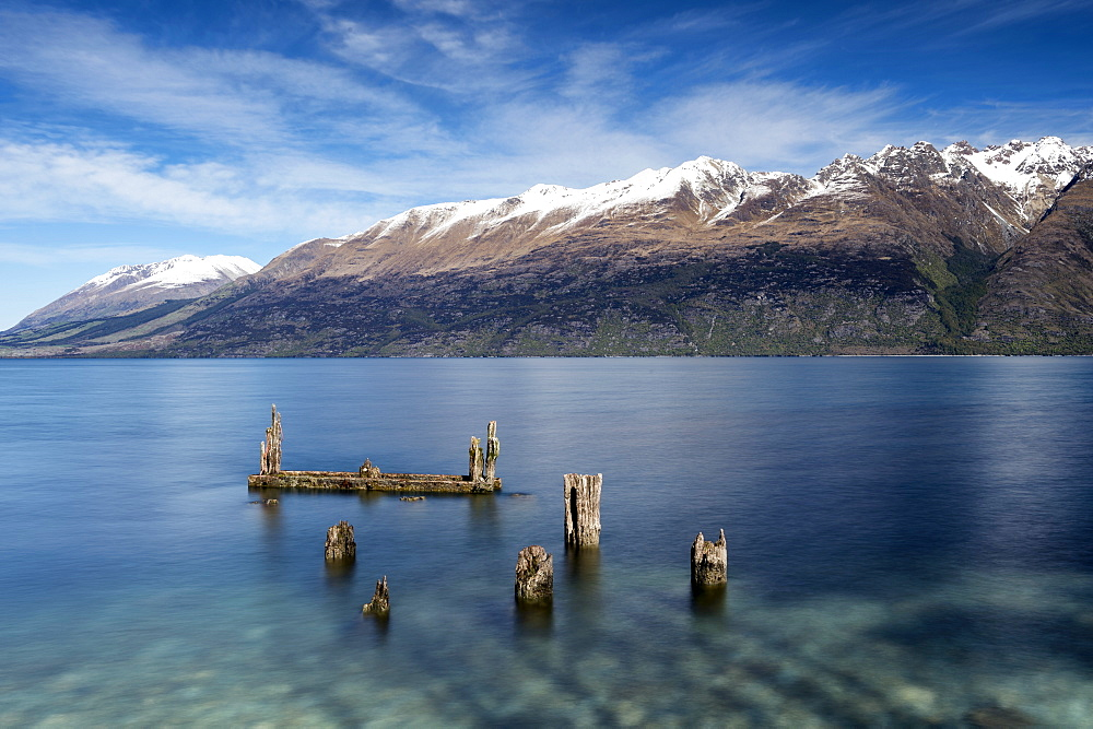 Decayed jetty, old wooden posts in Lake Wakatipu at Glenorchy, Otago Region, South Island, New Zealand, Pacific