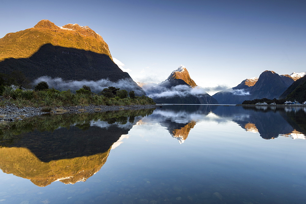 Low cloud lying below Mitre Peak at Milford Sound, Fiordland National Park, UNESCO World Heritage Site, South Island, New Zealand, Pacific