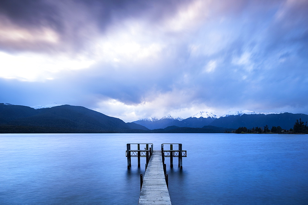 Te Anau jetty with lake and mountain in background, South Island, New Zealand