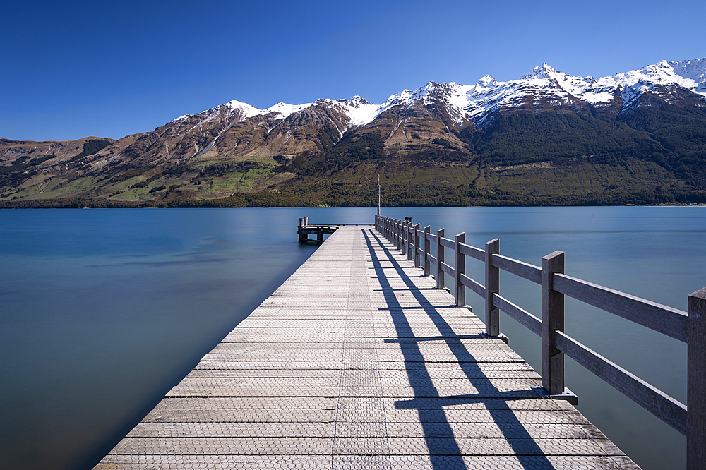 Wooden Jetty leading into turquoise Lake Wakitipu, Queenstown, New Zealand