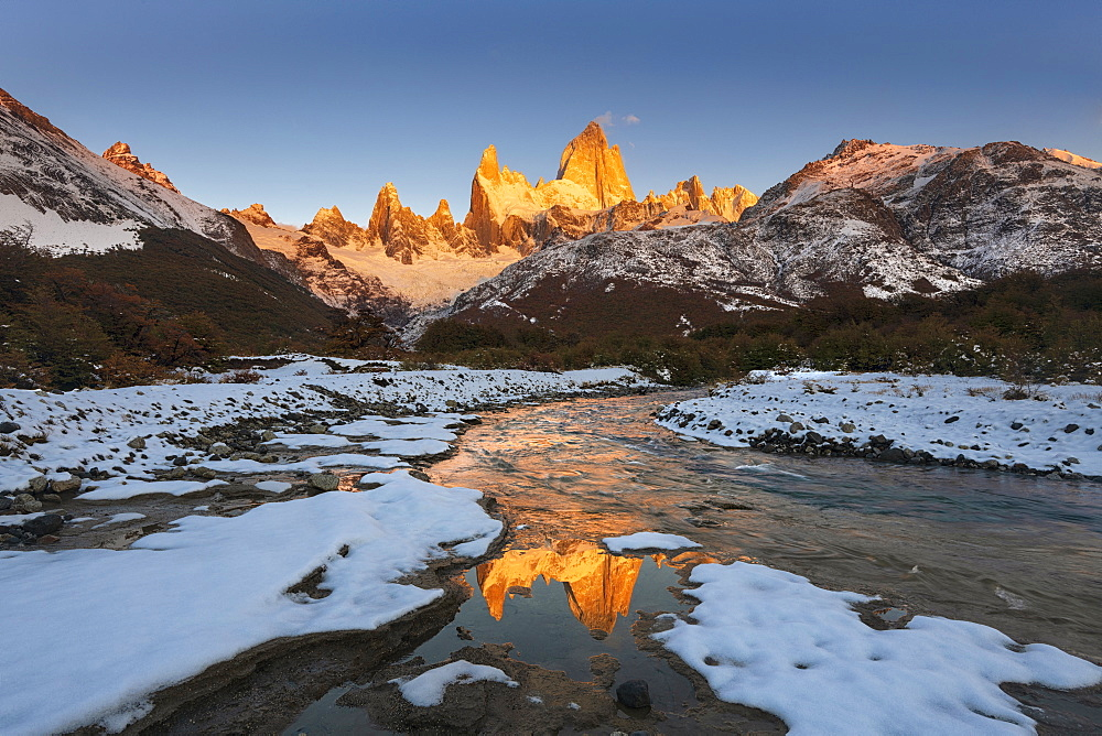 Mountain range with Cerro Fitz Roy at sunrise reflected in river, Los Glaciares National Park, UNESCO World Heritage Site, El Chalten, Patagonia, Argentina, South America - 1306-330
