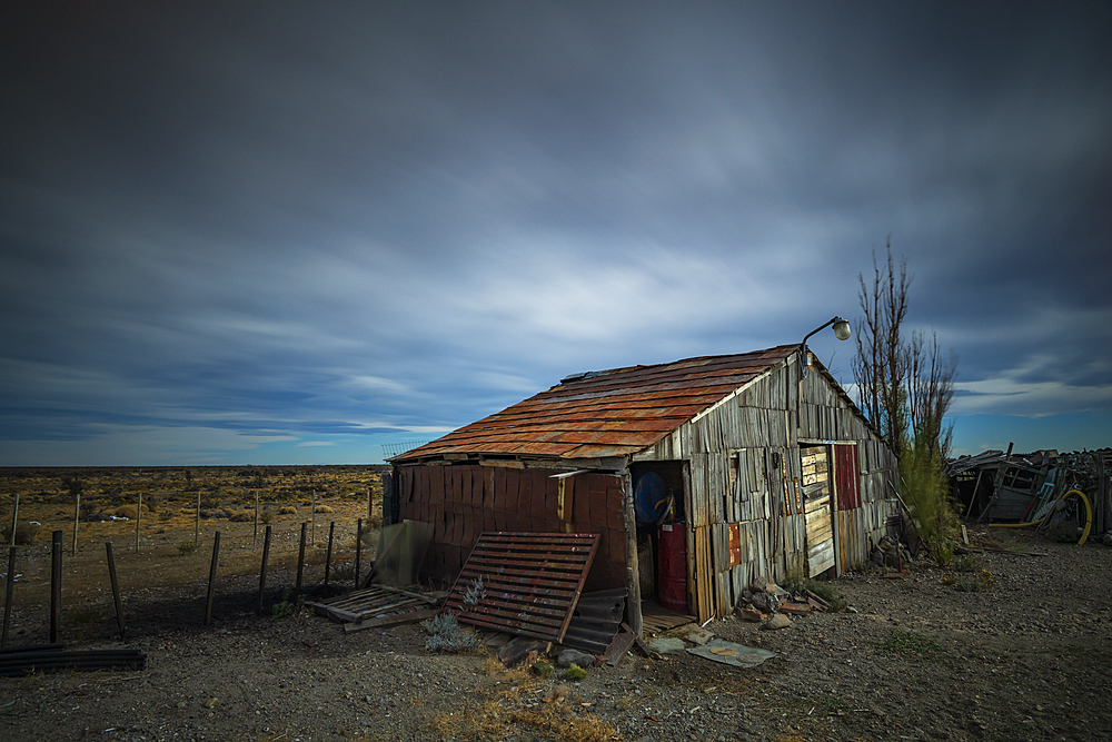 Old shed set against open landscape in Patagonia, Argentina, South America - 1306-338