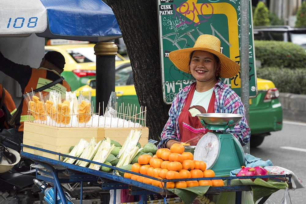 Female street vendor selling fruit and vegatables in Bangkok, Thailand, Southeast Asia, Asia