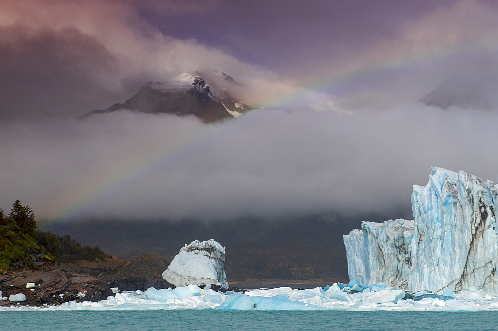 Rainbow and dramatic cloud over Perito Moreno Glacier in Los Glaciares National Park, UNESCO World Heritage Site, Patagonia, Argentina, South America