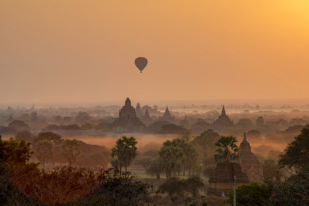 Hot air balloon flying over Stupas, Bagan (Pagan), Myanmar (Burma), Asia