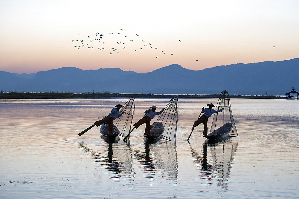 Three Intha Leg rowers on Inle Lake, Shan State, Myanmar (Burma), Asia