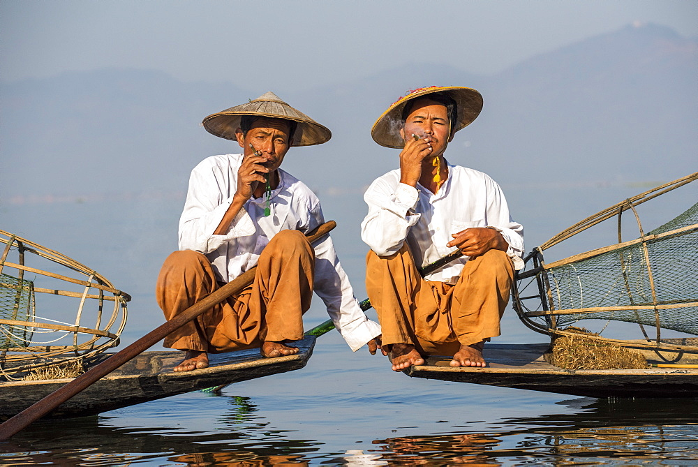 Two Intha leg rowing fishermen smoking cigars, Inle Lake, Shan State, Myanmar (Burma), Asia