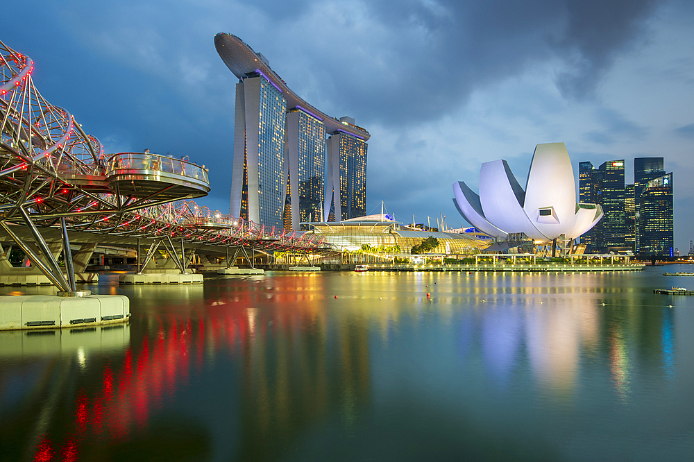 The Helix Bridge and Marina Bay Sands hotel at night, Singapore, Southeast Asia, Asia