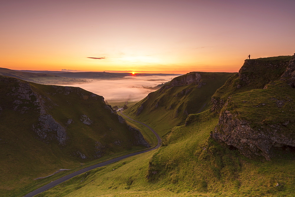A photographer at WInnats Pass at sunrise, Hope Valley, Edale, Derbyshire