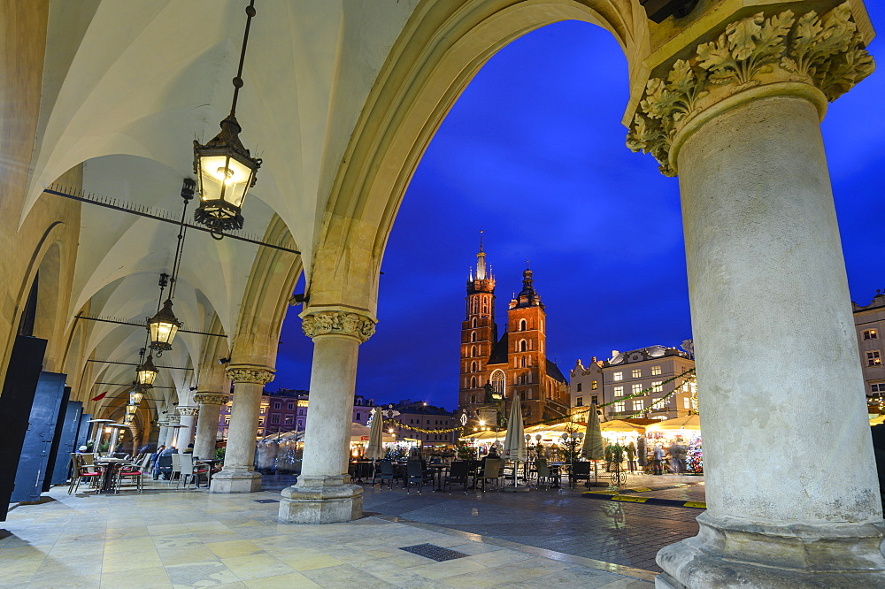 Exterior of Saint Mary's Basilica in Market Square at night, UNESCO World Heritage Site, Krakow, Poland
