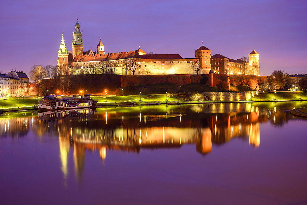 Wawel Castle, reflected in Vistula River, at night, Krakow, Poland
