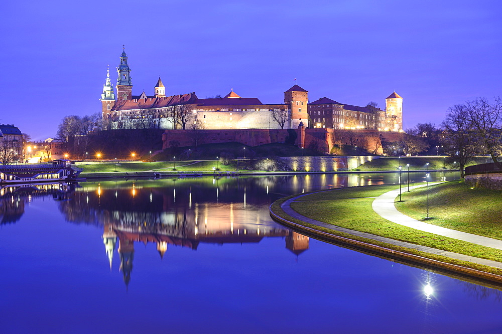 Wawel Castle reflected in the Vistula River, at night, Krakow, Poland
