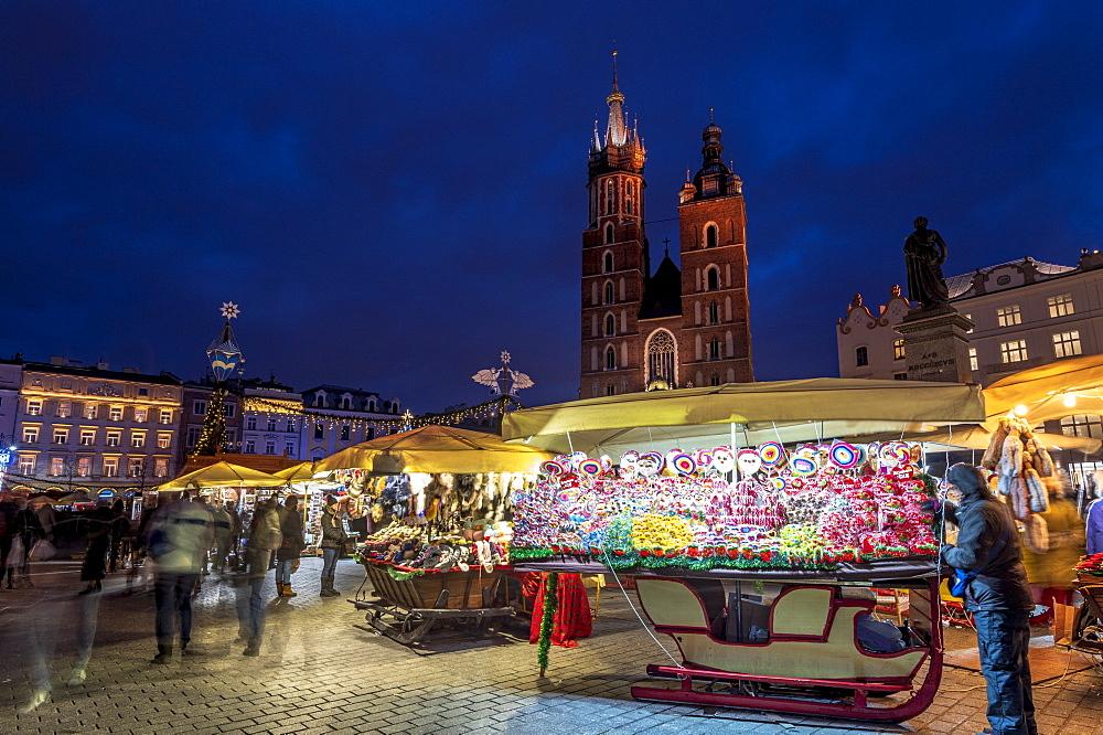 Christmas markets at night with Saint Mary's Basilica, Market Square, UNESCO World Heritage Site, Krakow, Poland, Europe