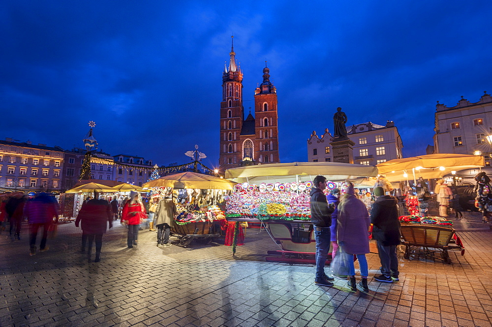 Christmas stalls at night with Saint Mary's Basilica, Market Square, Krakow, Poland