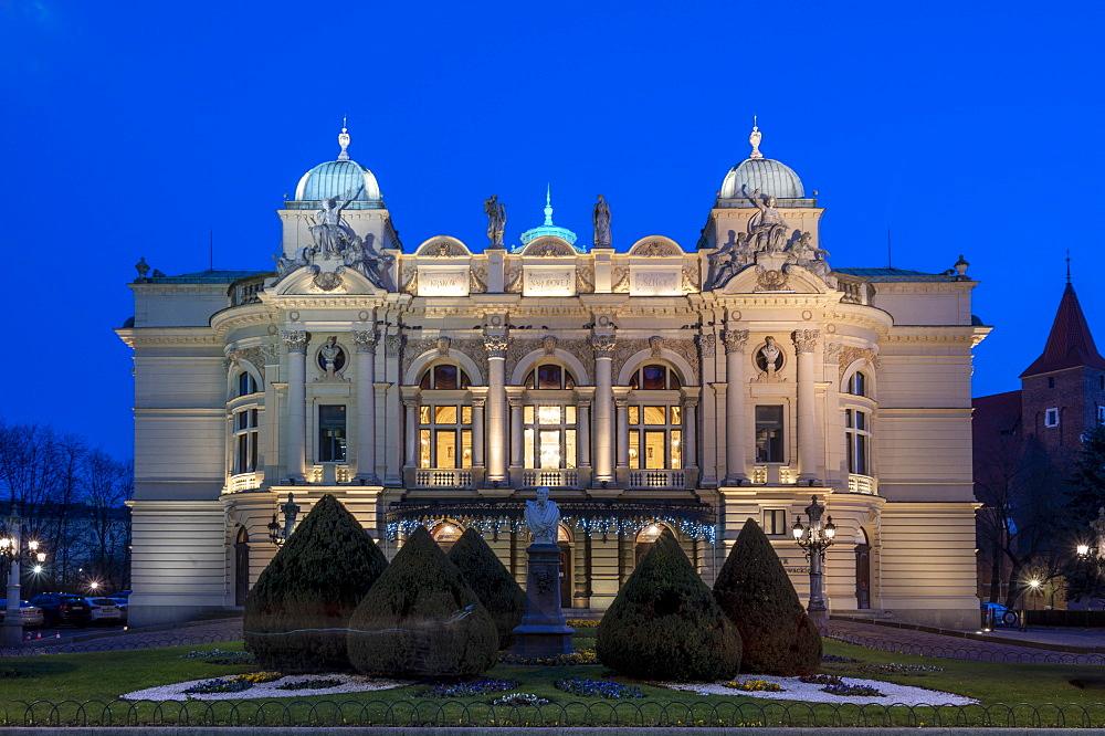 Juliusz Slowacki Theater opera house at night in Krakow, Poland