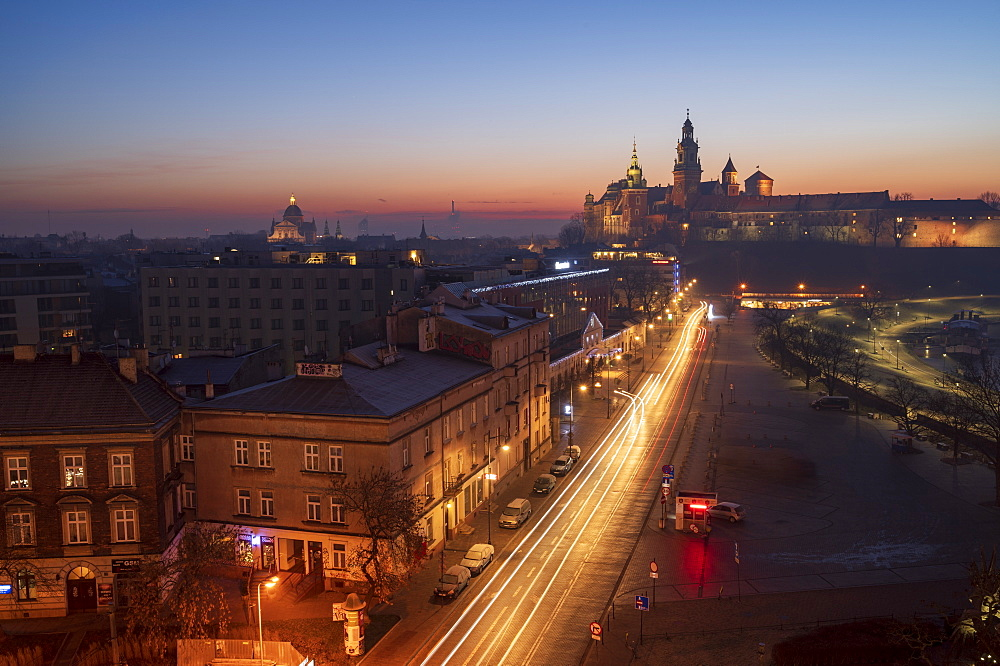Wawel Castle at sunrise, UNESCO World Heritage Site, with traffic trails, Krakow, Poland, Europe