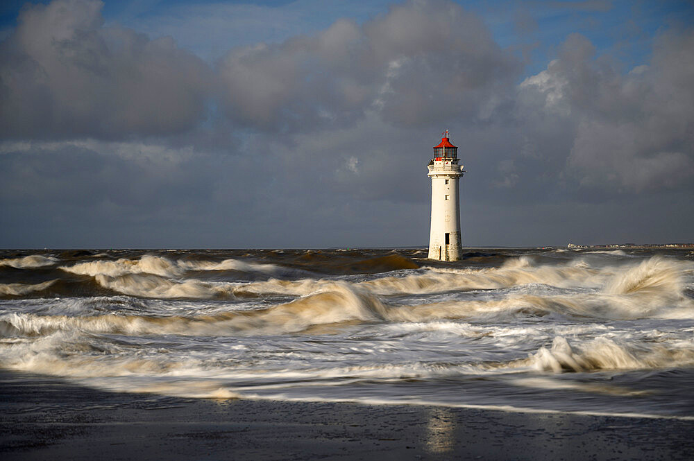 New Brighton lighthouse during stormy conditions, The Wirral, Cheshire, UK