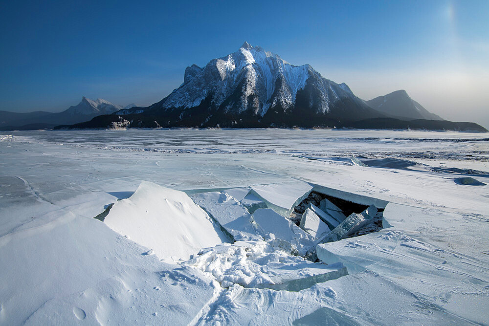Ice fracture at Abraham Lake frozen with Mount Michener, Alberta, Canada, North America