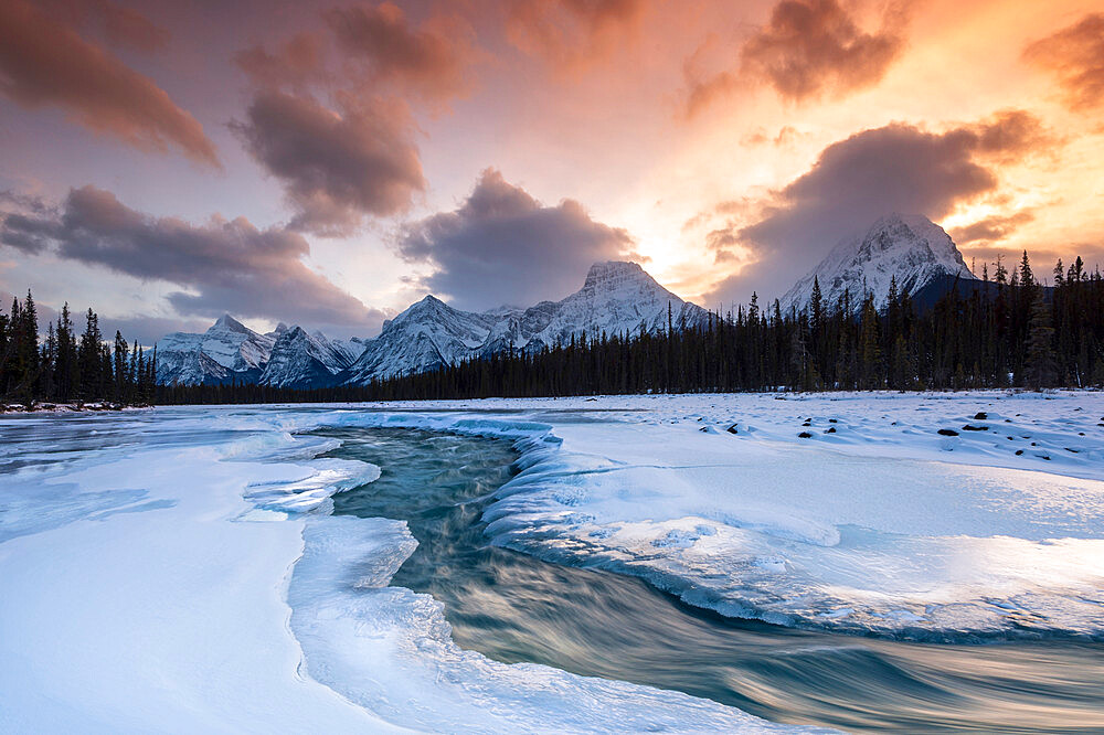 Athabasca River in winter with mountain backdrop, Alberta, Canada, North America - 1306-744