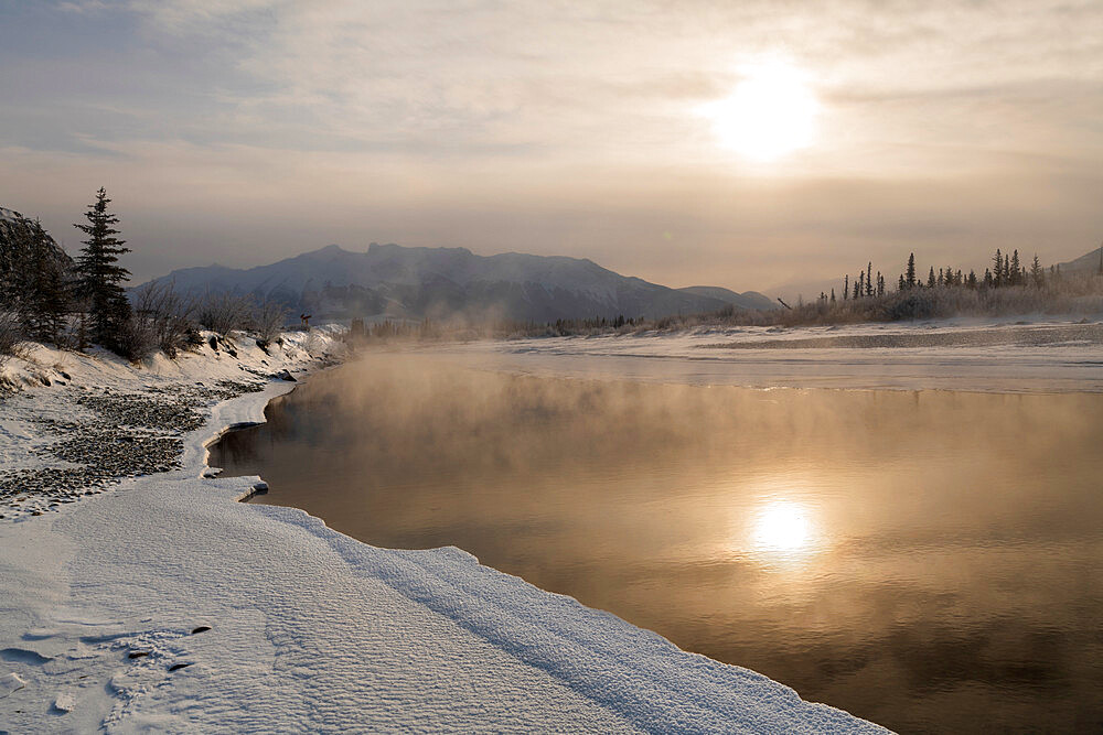 Reflected sun in Bow River in winter, Jasper, Canadian Rocky Mountains, Alberta, Canada, North America - 1306-746