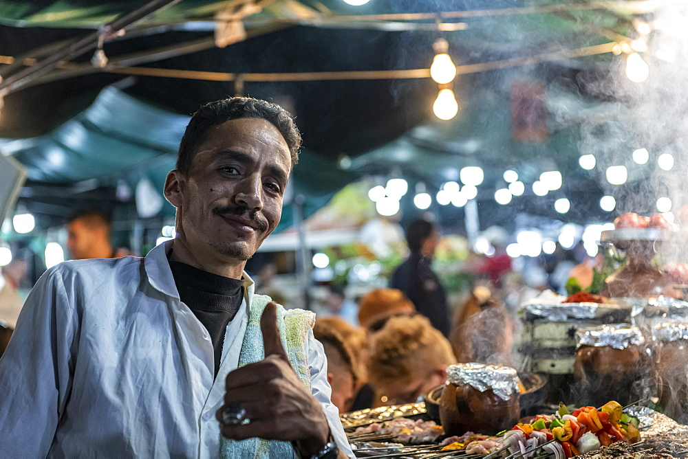 Market stall worker and chefs cooking, Djemaa El Fna Square, Marrakesh, Morocco, North Africa, Africa