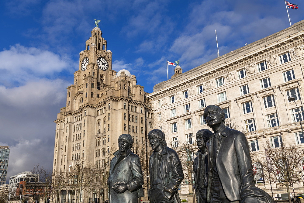 Bronze statue of the four Liverpool Beatles stands on Liverpool Waterfront, UNESCO World Heritage Site, Liverpool, Merseyside, England, United Kingdom, Europe - 1306-771
