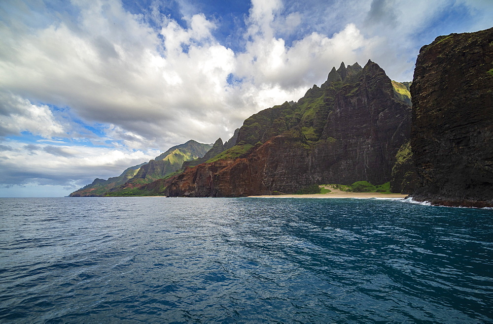 Na Pali Coast from sea level showing isolated beach typical of the north west coast of Kauai, United States of America