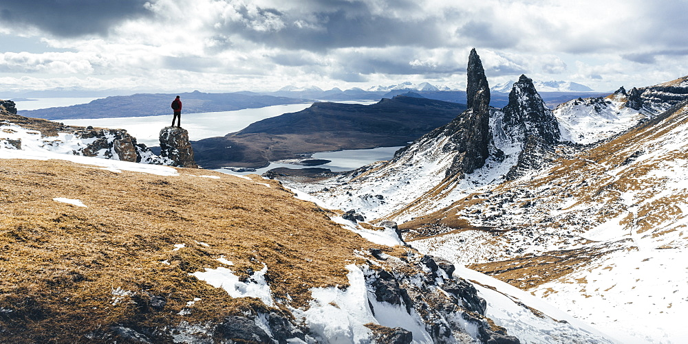 Hiker admiring view towards the Old Man of Storr, near Portree, Isle of Skye, Inner Hebrides, Highland, Scotland, United Kingdom, Europe - 1309-3
