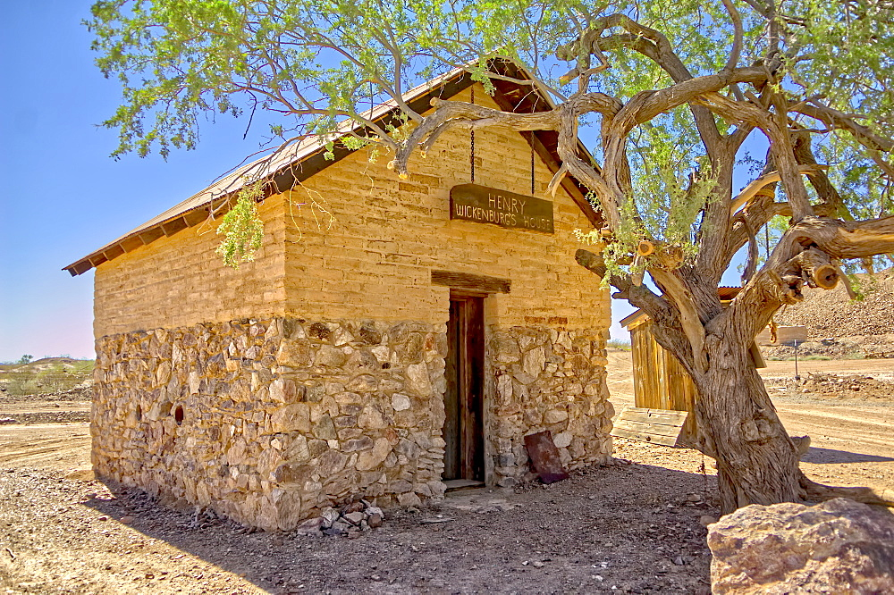 An outside view of the historic cabin of Henry Wickenburg, founder of Vulture City and the town of Wickenburg Arizona.