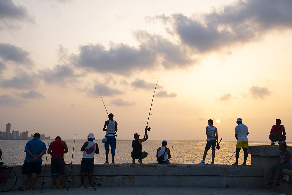 Fishing along the Malecon at sunset, Havana, Cuba, West Indies, Caribbean, Central America