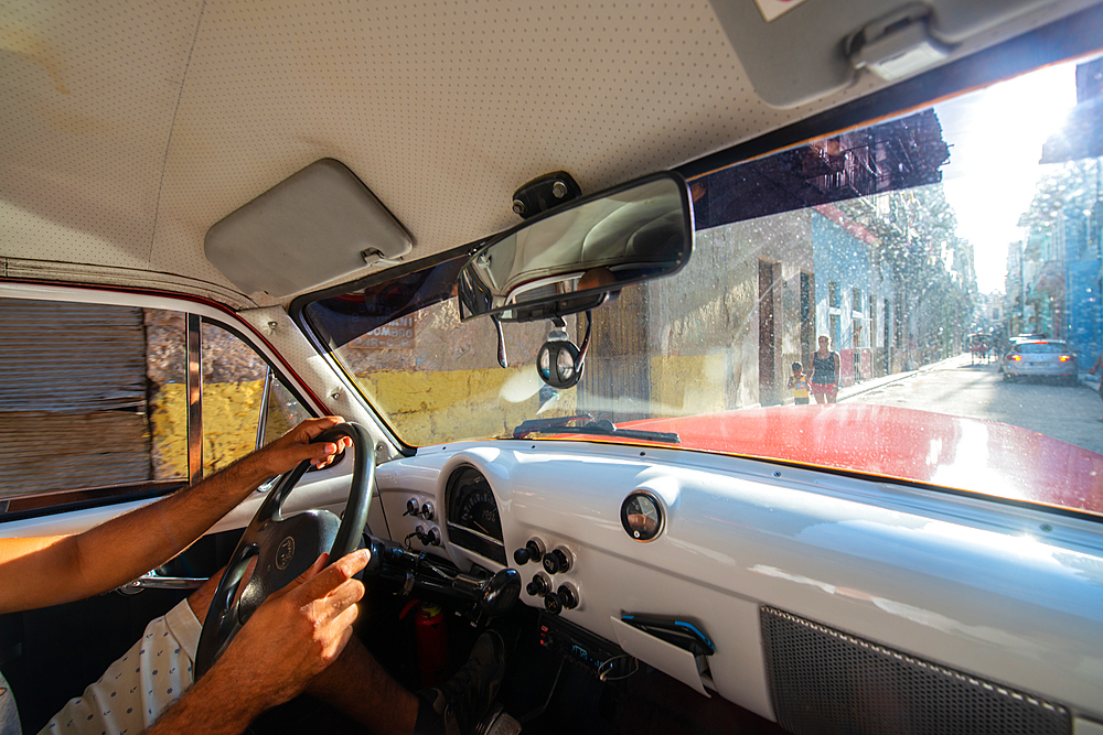 Interior of a vintage car driving in Havana, Cuba, West Indies, Caribbean, Central America