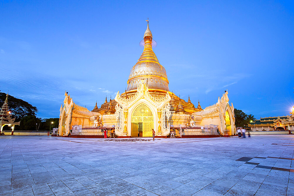 A wide view of Maha Wizaya Pagoda during blue hour