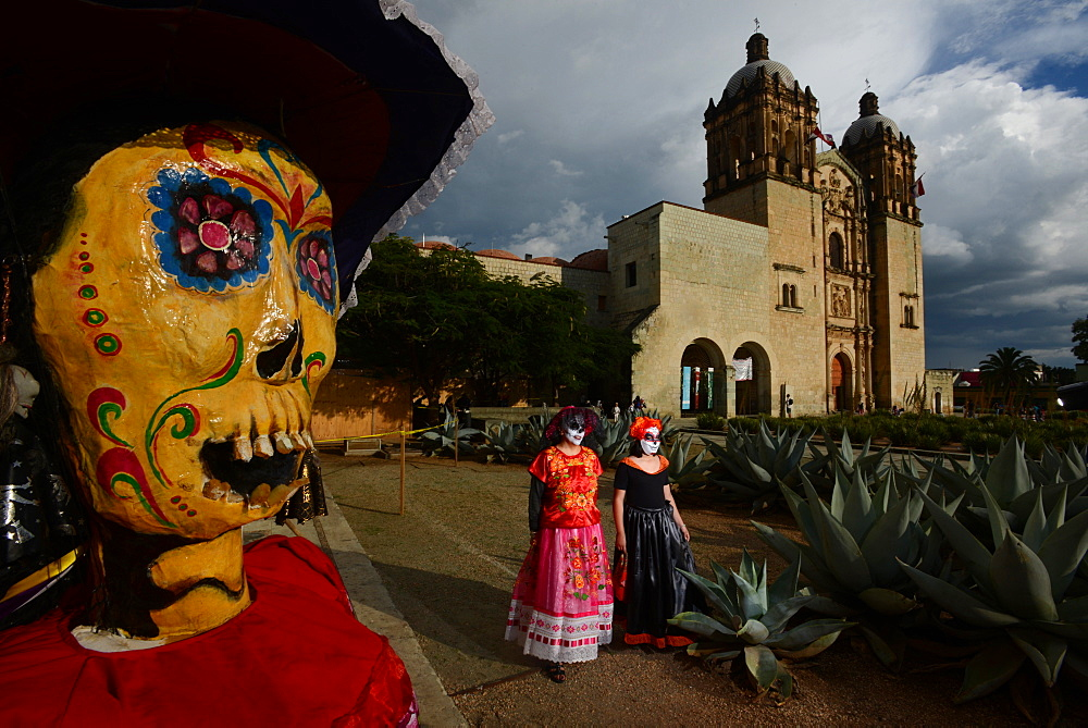 People participating in comparsas or street dances during the Day of The Dead Celebration.