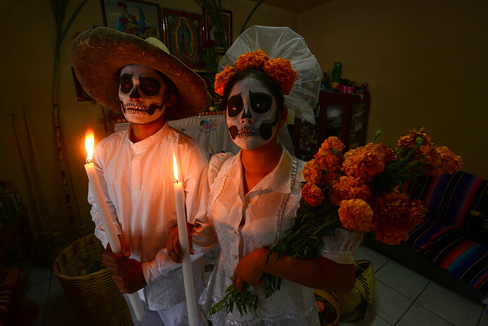 Couple depicting a wedding holding candles and marigolds during the Day of the Dead Celebration, Mitla, Oaxaca, Mexico, North America